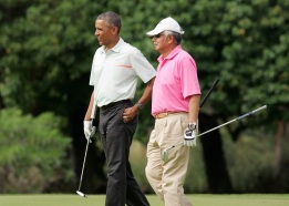 U.S. President Barack Obama and Malaysia's Prime Minister Najib Razak walk off 18th hole while playing a round of golf at the Clipper Golf course in Hawaii